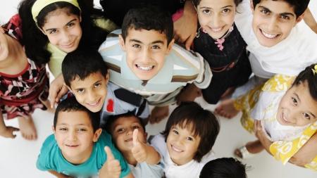 Las personas más sonrientes del mundo viven en países de inmigrantes.