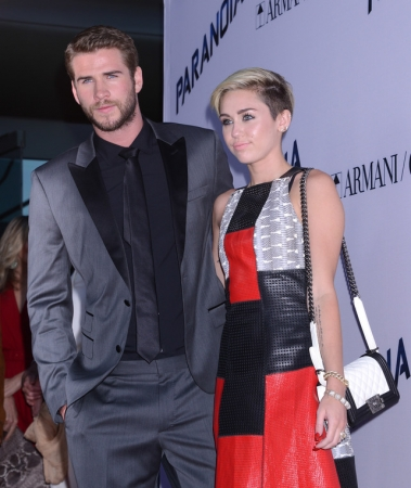 "Actress and singer Miley Cyrus and actor Liam Hemsworth at the premiere of "" Paranoia "" in Los Angeles on Thursday, Aug. 8, 2013"